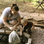 My Wife and Son releasing fish into our pond.