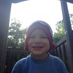 My silly son wearing a stocking cap and gloves in June!